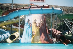 colleagues having fun at a waterpark outdoors