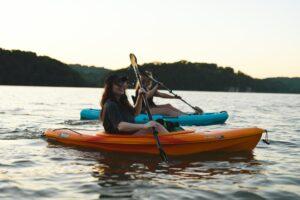 work teams kayaking together outdoors