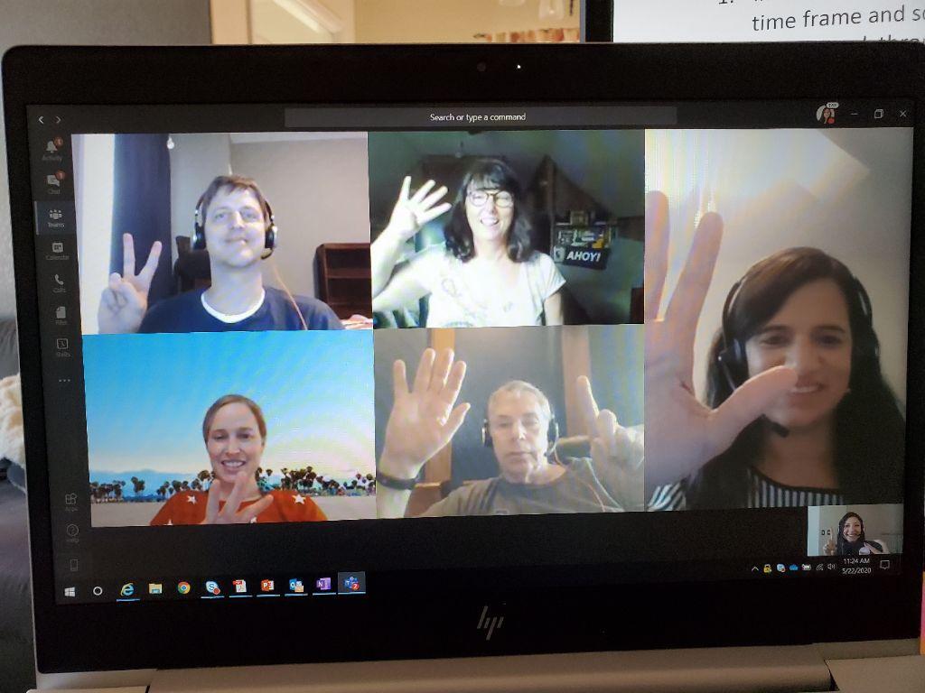 team members doing a fun virtual clue murder mystery