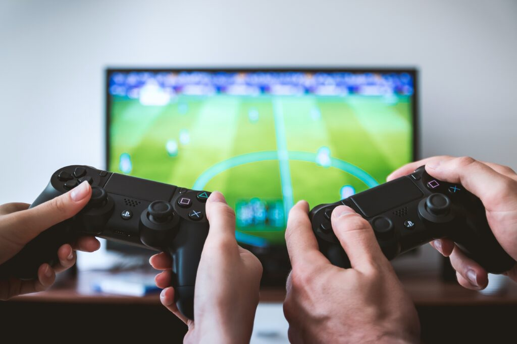 hobby-themed team building questions section image with two people playing playstation