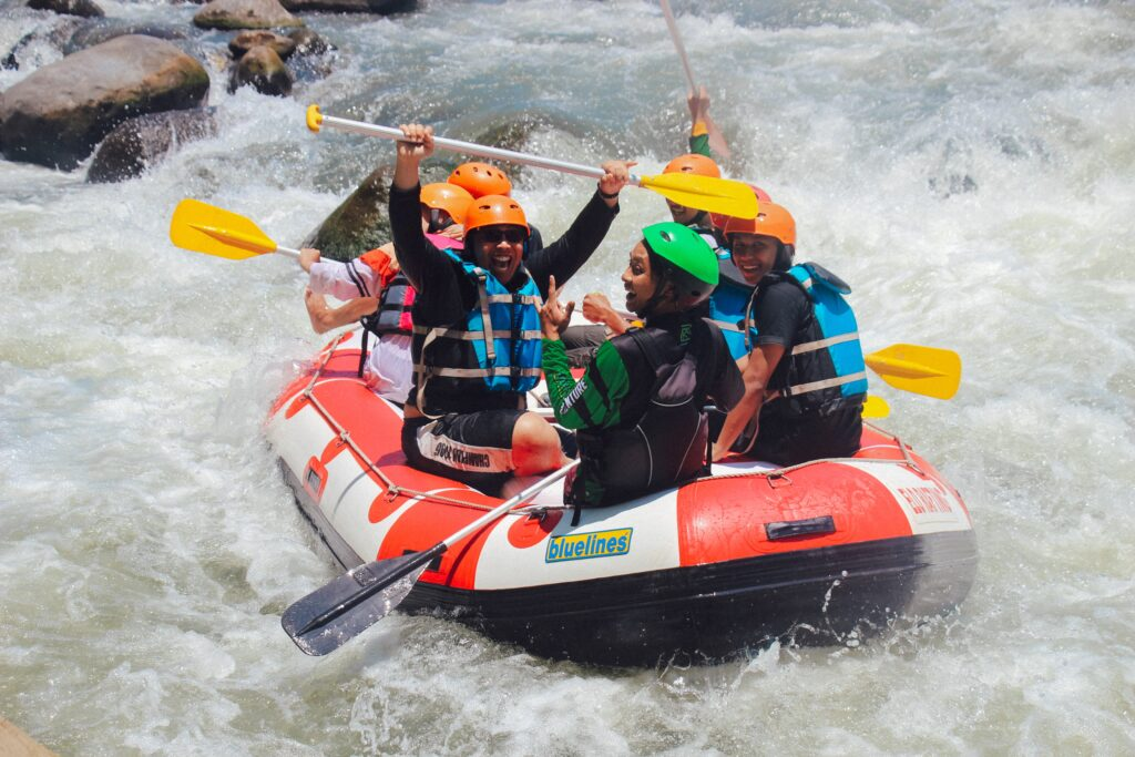 colleagues rafting for summer team building