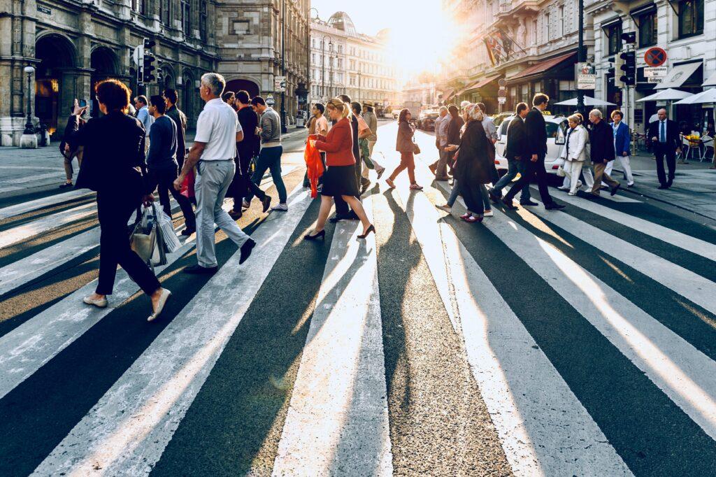 people walking around a big city