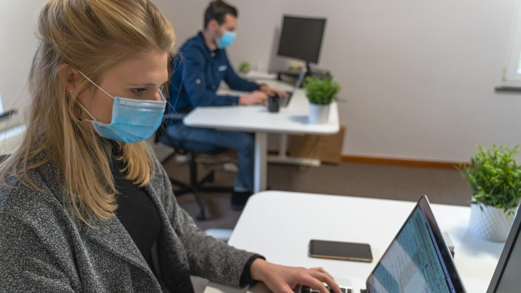 an employee returning to work in an office after the pandemic