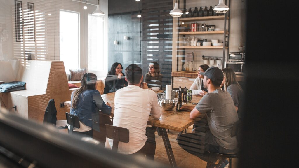 teammates having a meeting in a hybrid work environment