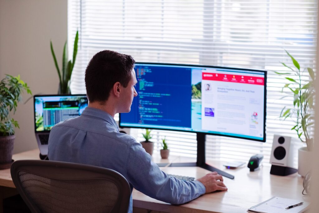 a man using a computer and software tools to engage with his remote team