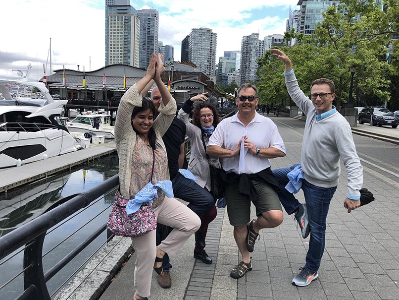 colleagues doing an outdoor wild goose chase team building activity after covid 19